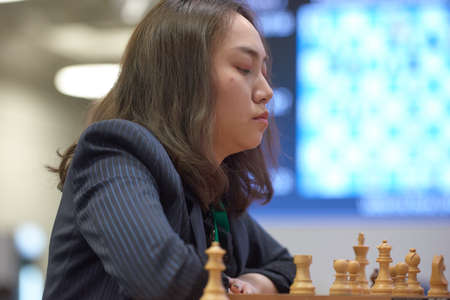 St. Petersburg, Russia - December 30, 2018: Grandmaster Lei Tingjie, China competes in King Salman World Blitz Chess Championship 2018. Eventually she took 3rd place