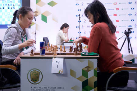 St. Petersburg, Russia - December 28, 2018: Match World Champion Ju Wenjun, China (rightt) vs Zhansaya Abdumalik, Kazakhstan during King Salman World Rapid Chess Championship 2018. The match ended in a draw