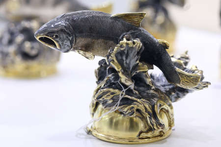 St. Petersburg, Russia - February 1, 2019: Golden fish on the exhibition of jewelry in animal style in the opening day of jewelry festival Faberge Heritage