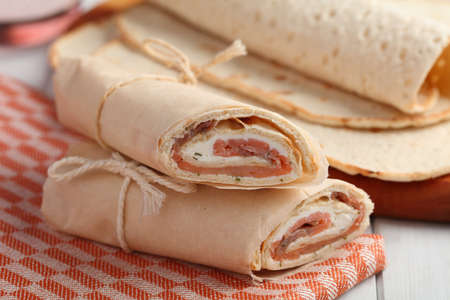 Swedish traditional roll with salmon and soft cheese closeup