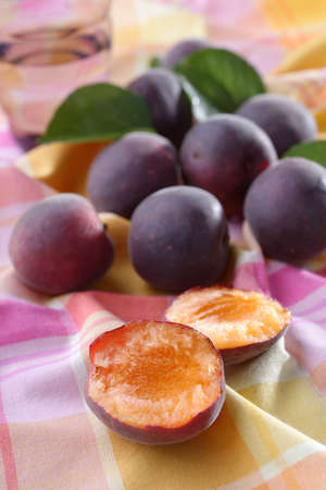 Fresh ripe black apricot fruits on a rustic table
