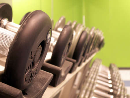 fitness club: perspective shot of freeweights on the rack in a fitness center Stock Photo