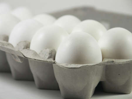 carton of a dozen eggs with focus on front corner of carton Stock Photo - 259465