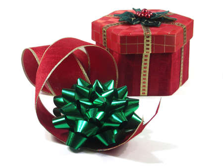 red box and green bow with curling red ribbon isolated on white. shallow depth of field. focus on green bow.