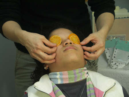 A woman getting a facial massage. The focus is on the womans mouth and nose.