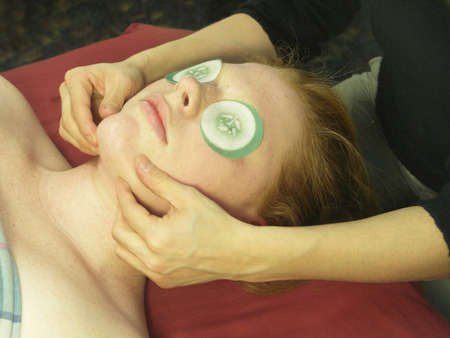 A woman getting a massage. The focus is on the womans face.