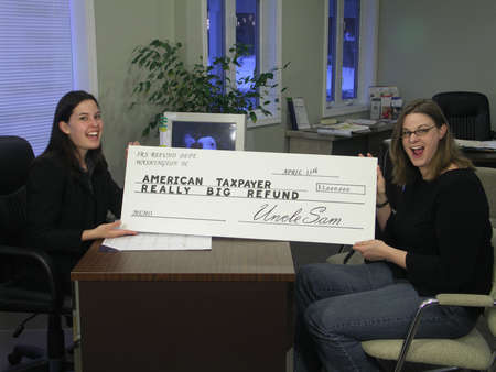 exemptions: A surprised woman receives an oversized tax refund check.