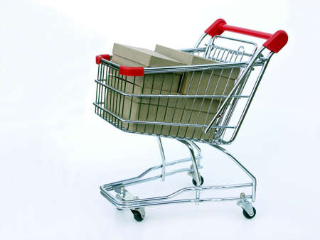 Miniature shopping cart isolated on white filled with blank boxes.