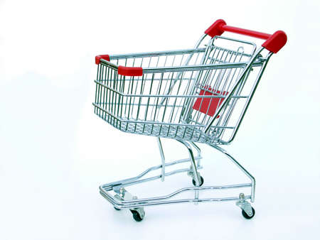 Miniature shopping cart isolated on white.