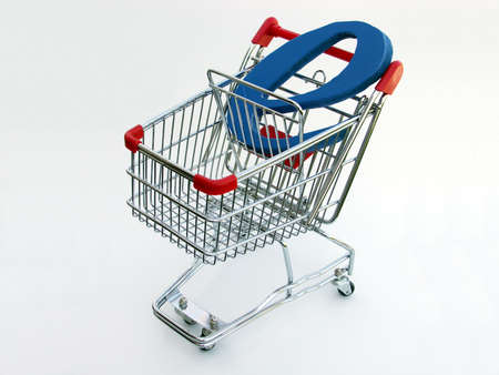 A miniature shopping cart isolated on white with a blue letter