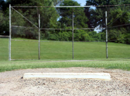backstop: View from the pitchers mound. Focus on mound. Stock Photo