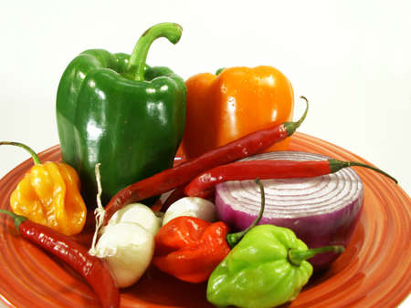 peppers on a plate against white
