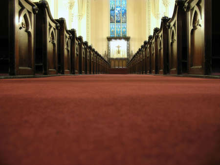 View of the altar past the pews down the aisle low perspective.