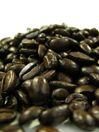 energizing: Close up of coffee beans on white