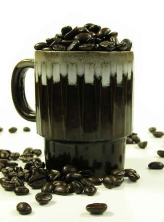 Brown coffee mug with coffee beans on white. Stock Photo - 753892