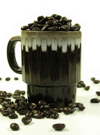Brown coffee mug with coffee beans on white. Stock Photo - 753892