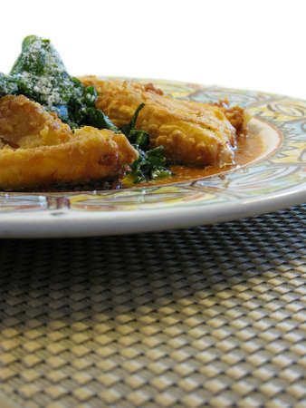 fried cheese and spinach on a plate.