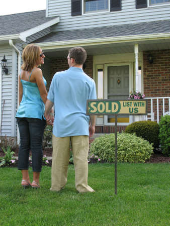 Couple outside of newly purchased house