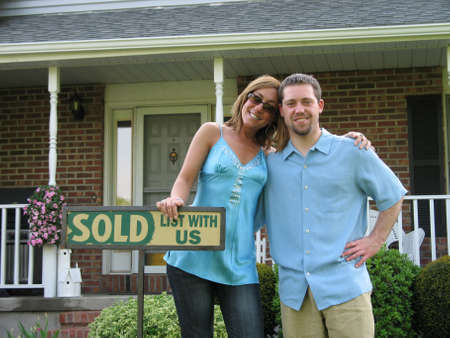 Couple outside of newly purchased house photo