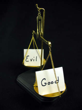good: Good and evil cards on a gold scale.