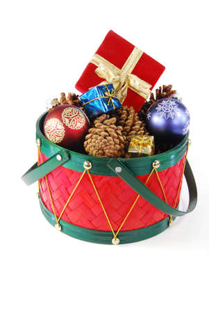 Various holiday decorations in a red drum isolated photo
