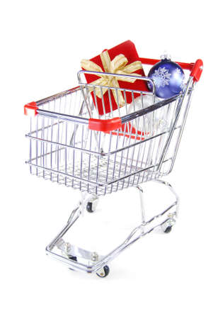 Red present and ornaments in a shopping cart photo