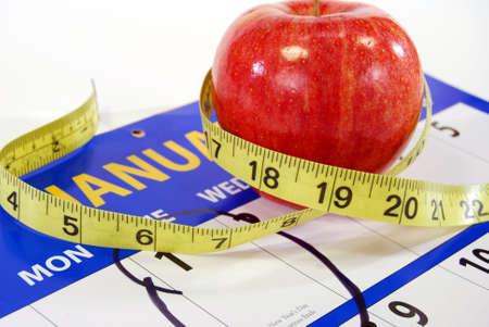 circled: Manzana roja y brillante a medida con la medida de un calendario con un c�rculo 1ro de enero.