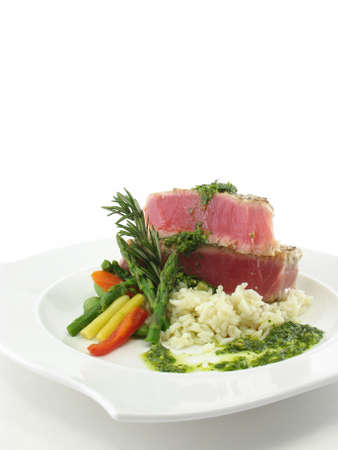 Tuna steak on a white plate isolated on white. photo