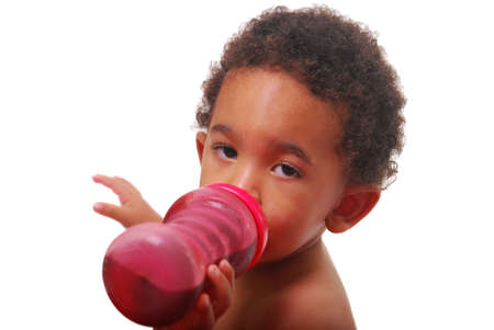 A multi-racial baby boy drinking. photo