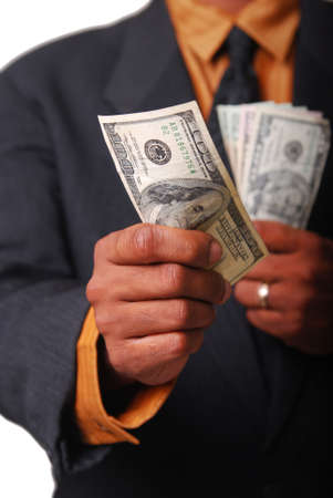 African-American male hands holding American currency with single bill in focus. Stock Photo - 3728738