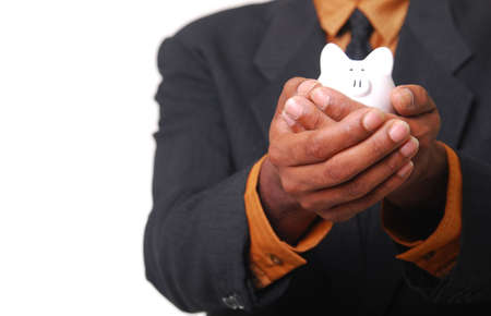 African-American male hands cradling a piggy bank. photo