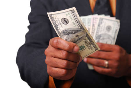 giving money: African-American male hands holding American currency with single bill in focus. Stock Photo