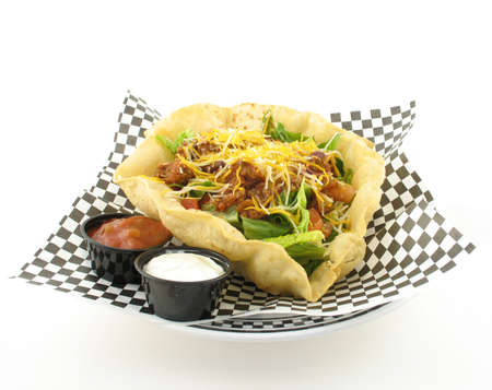 side of beef: taco salad with beef in a taco shell bowl with salsa and sour cream on side Stock Photo