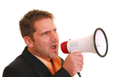 Business man yelling into a megaphone isolated against white
