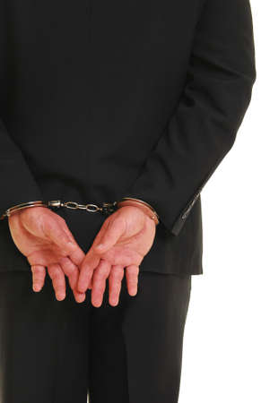 causal: Business man in handcuffs isolated on white Stock Photo