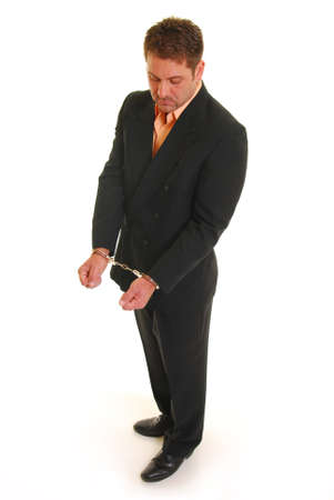 Business man in handcuffs isolated on white Stock Photo - 4326828