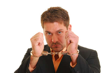 Business man in handcuffs isolated on white Stock Photo - 4326839