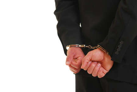 handcuffed: Business man in handcuffs isolated on white Stock Photo