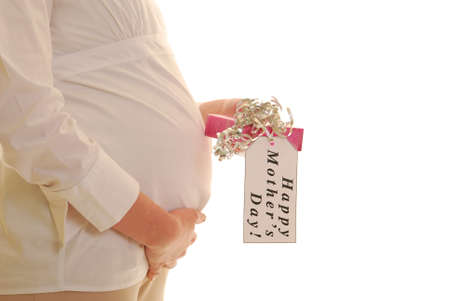 Pregnant woman profile holding Mothers Day present with tag photo