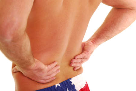 back ache: Man with lower back pain isolated on white