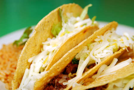 Tacos, refried beans and rice on a plate Stock Photo