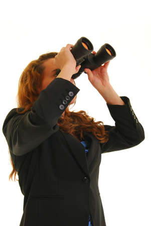 Business woman looking through binoculars photo