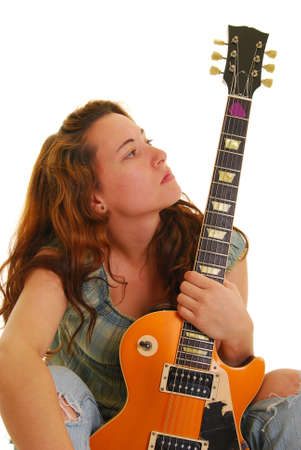 Attractive young woman holding a guitar Stock Photo - 4872816
