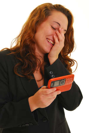 Woman holding cell phone laughing Stock Photo - 4874519
