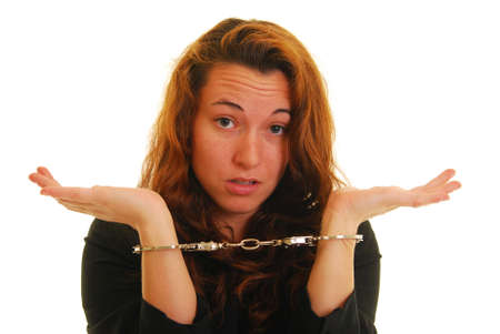 Attractive Caucasian woman in suit jacket and handcuffs Stock Photo - 4926932