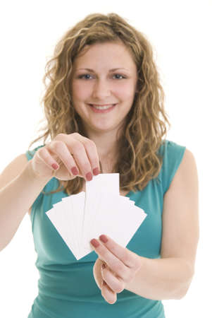 business cards: Attractive woman holding blank business fanned cards. Focus on hand and cards.