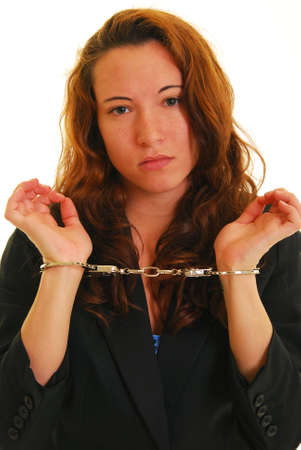 Attractive Caucasian woman in suit jacket and handcuffs photo
