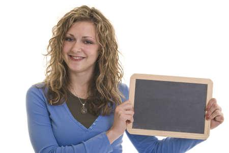 A beautiful Caucasian woman holding a blank chalkboard photo