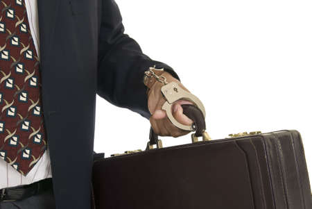 cuffed: African American male hand cuffed to a briefcase. Stock Photo