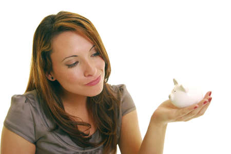 Attractive Caucasian woman holding piggy bank. Stock Photo - 5446295